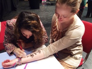Delegates get henna tattoos at ITATI